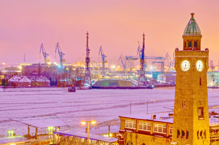Hamburg, Germany, frozen river and the same harbor at sunset pink. Stock Photo