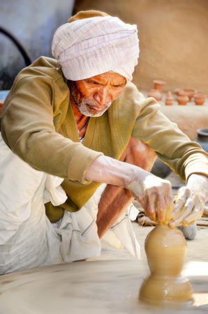 Rajasthan, India. february 13th. An unidentified man is making traditional pottery Rajathan in rajasthan, india on february 13th 2012. Potery is a traditional craft in Rajasthan. Editorial