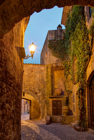 narrow street: Famous medieval Town Pals by night, Costa Brava, Spain   Stock Photo