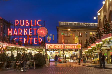 Christmas lights and festive holiday decorations at dusk, Pike Place Market, Seattle, Washington, United States. Famous local shopping destination travel landmark. Editorial use only.