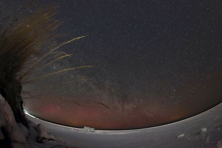Milky way over the frozen lake Baikal. Starry sky in Siberia. Banco de Imagens