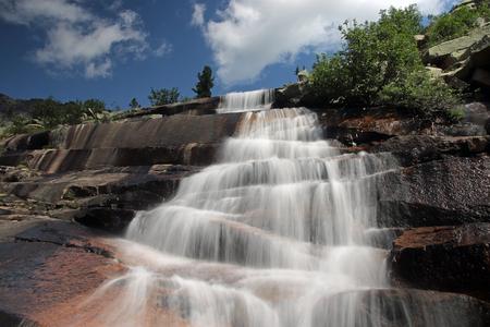Beautiful waterfall in the mountain range Ergaki, Russia.