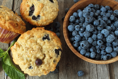 oatmeal: blueberry muffins and oatmeal on wooden board