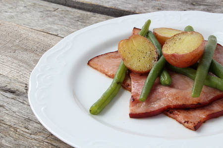 creamer: Plate of ham, green beans and creamer potato, cooked in butter
