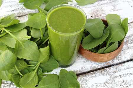 smoothie: Spinach smoothie on paint wooden board
