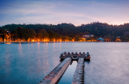 double page spread: Kandy Lake and the Temple of the Sacred Tooth Relic (Temple of the Tooth, Sri Dalada Maligawa) at dawn, Kandy, Central Province, Sri Lanka, Asia.