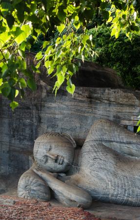 attaining: Polonnaruwa Ancient City, reclining Buddha in Nirvana at Gal Vihara Rock Temple (Gal Viharaya),