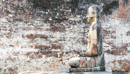 polonnaruwa: Ancient City of Polonnaruwa, stone Buddha statue at Vatadage (Circular Relic House) in Polonnaruwa Quadrangle, Sri Lanka, Asia. Stock Photo