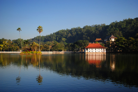 Artificial lake of the city of Kandy in the solar morning. Sri Lanka