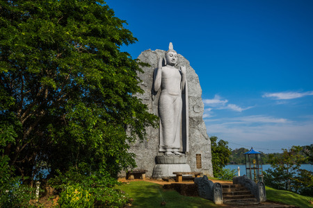 Large Buddha statue at Giritale Lake (Giritale Wewa) in North Central Province, Cultural Triangle, Sri Lanka, Asia
