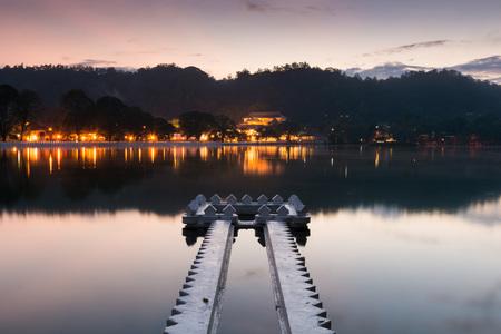 Kandy Lake and the Temple of the Sacred Tooth Relic (Sri Dalada Maligawa) at Sunrise, Kandy, Sri Lanka, Asia Stock Photo