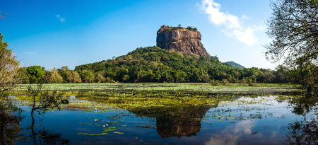 Panoramic picture of Sigiriya Rock Fortress, (a UNESCO world heritage Site) seen from Sigiriya Lake in the cultural triangle of Sri Lanka, Asia Banco de Imagens