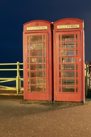 phonebooth: Night scene of two Red Phone Boxes in Brighton, England  Stock Photo