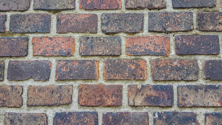 Red Vintage Brick Wall Wallpaper Background Texture.Close Up of Colorful Red Bricks Pattern