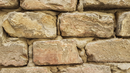 Stone Brick Wall Wallpaper Background Texture .Close Up of Old Yellow Rock Bricks