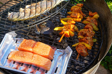 Fish, salmon and chicken Skewer on the grill.