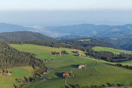 Amazing landscape of the Black Forest in the morning with fog during sunrise, seen from a hot-air ballon, Hinterzarten, Germany Banco de Imagens