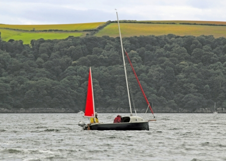 ketch: Yacht hugging the coastline  Stock Photo