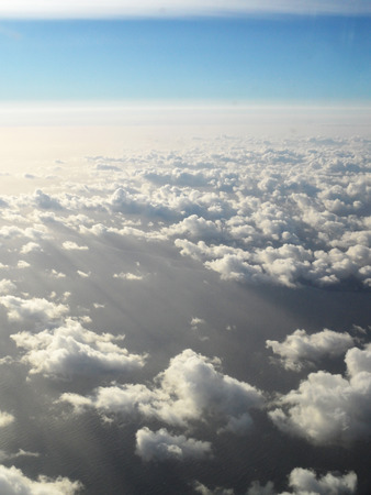 Above the Clouds the sun is shining photo