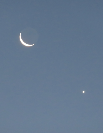 waxing gibbous: Crescent Moon, Earth Shadow and Venus Stock Photo
