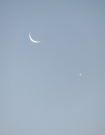 waxing gibbous: Pale blue Sky with Mioon and Venus Stock Photo