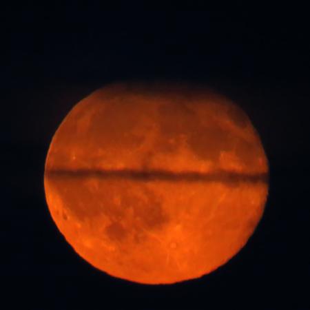 waning moon: Cloudy Orange Moon