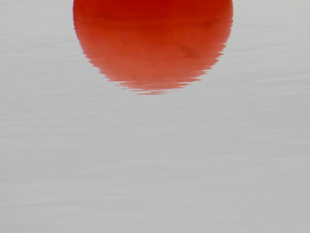 Red Sun Reflection In Water