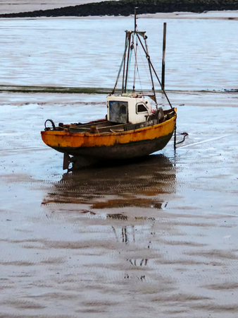 Fishing Boat On Mud Flats