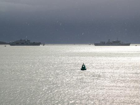 Warships On The Horizon In The Rain