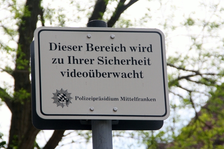 April 2007, 29 - Nuremberg, Germany - Warning Sign (This area is video-monitored for your safety) of Middle Franconia Police Department