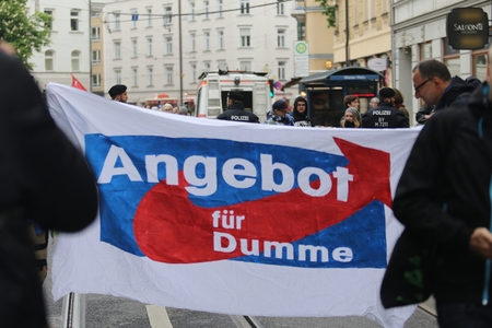 May 2016, 15 - Munich, Germany, protesters against right-wing party AFD showing transparent: AFD as Offer For the Stupid Editorial