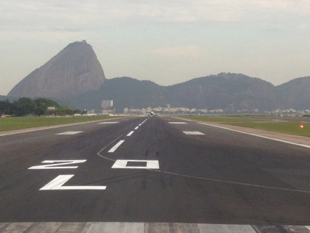 lining up: Sugar Loaf captured as we were lining up on the main runway of Santos Dumond Airport Downtown Rio.