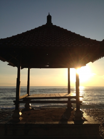 sanur: Sunrise at Sanur Beach Bali from one of the small temples that are spread throughout the beaches in the island.