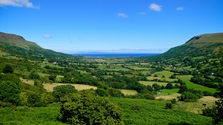 Landscape of Glenariff looking east across the Sea of Moyle with the coast of Scotland in the background. Stockfoto