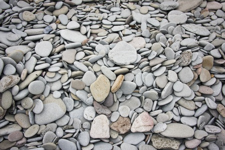 Pile of water-eroded stones on a beach.