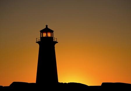 Peggys Cove lighthouse at sunset photo