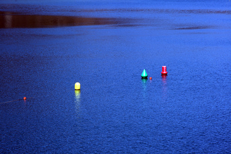 delimit: Buoys colors at sunset