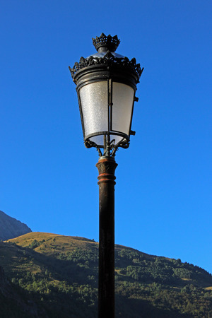 iron oxide: Lamppost in a town of Mountain Stock Photo