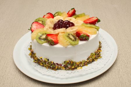 Beautiful decorated fruit cake with nuts