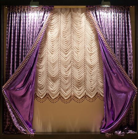 Luxurious old-fashioned designer window curtains in purple and white Stock Photo