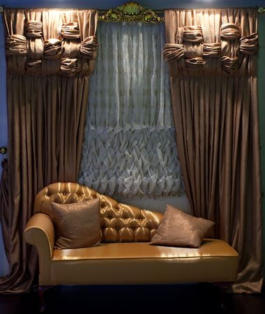 Luxurious old-fashioned designer sofa and window curtains in brown and white