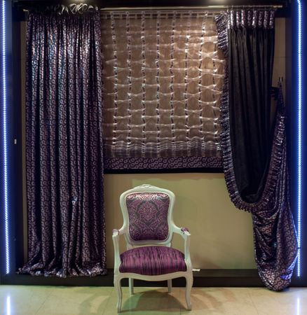 designer chair: Luxurious old-fashioned designer chair and window curtains in purple