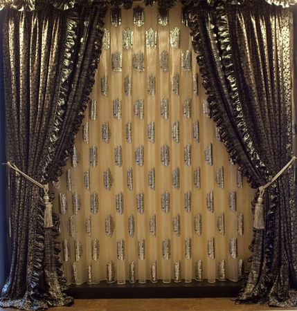 Luxurious old-fashioned designer window curtains in gold photo