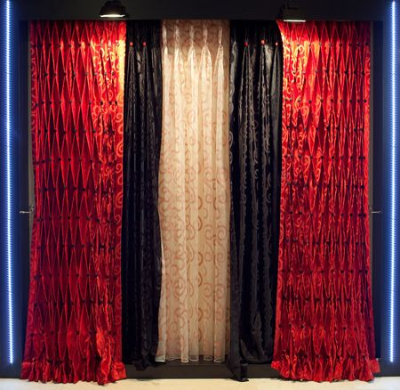 Luxurious designer window curtains in red, black and white Stock Photo