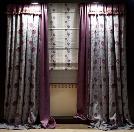 Luxurious old-fashioned designer window curtains with flowers Stock Photo
