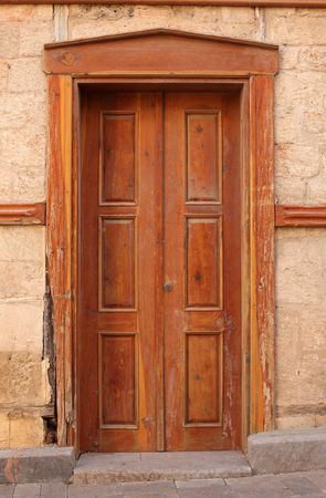 Old door and ancient wall in Turkey photo