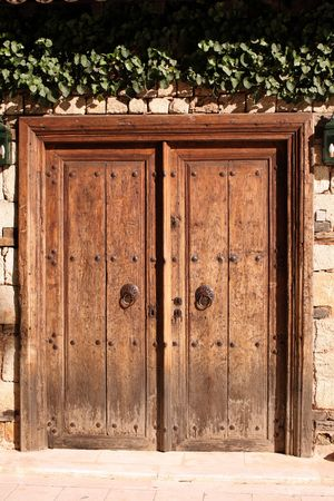 Old door with two round iron knockers and four keyholes in Turkey photo