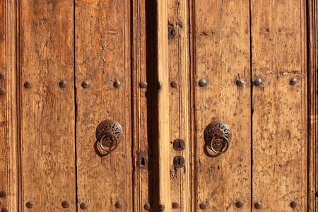 Old door with two iron knockers and four keyholes in Turkey photo