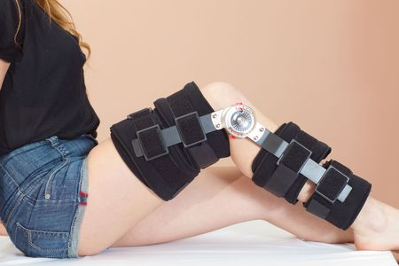 Adjustable angle support for leg or knee injury, side view Stock Photo