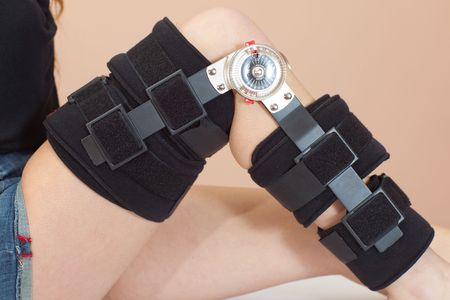 Adjustable angle support for leg or knee injury, side view, close-up photo